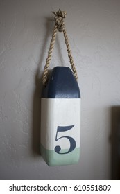 Number 5 Buoy Decoration in Beach House Bedroom