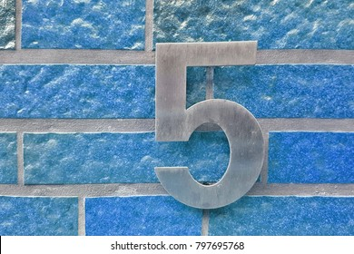 Number 5 house number on the wall