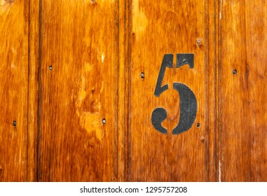 number 5 on door of storage room for tenants in century-old apartment building in stockholm