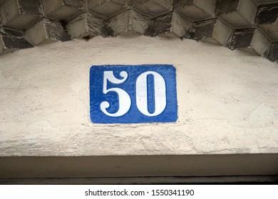 Number 50 . Street number plate.