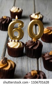 Number 60 celebration birthday cupcakes on a wooden background