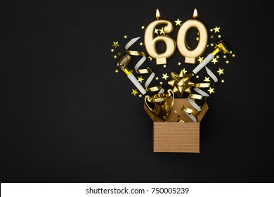 Number 60 gold celebration candle and gift box background