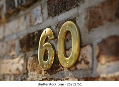 The number 60 on brick