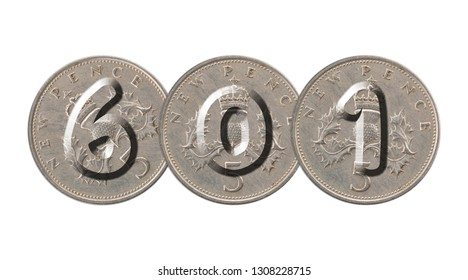 Number 601  with old coins on white background