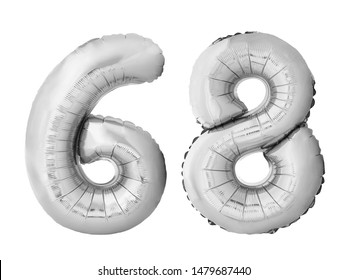 Number 68 sixty eight made of silver inflatable balloons isolated on white background. Silver chrome helium balloons forming 68 sixty eight number