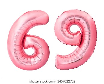 Number 69 sixty nine made of rose gold inflatable balloons isolated on white background. Pink helium balloons forming 69 sixty nine number