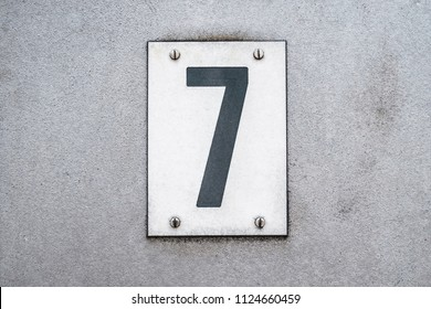 Number 7 / seven on metal background / house number