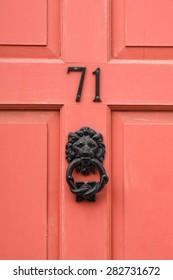 Number 71 seventy one painted door and lion head door knocker detail
