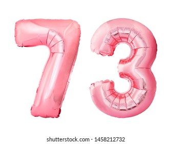 Number 73 seventy three of rose gold inflatable balloons isolated on white background. Pink helium balloons forming 73 seventy three