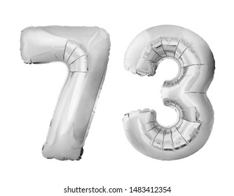 Number 73 seventy three of silver inflatable balloons isolated on white background. Silver chrome helium balloons forming 73 seventy three
