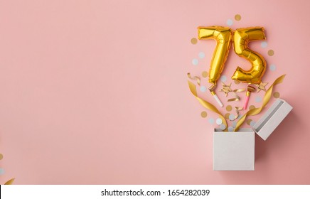 Number 75 birthday balloon celebration gift box lay flat explosion
