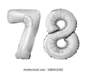 Number 78 seventy eight of silver inflatable balloons isolated on white background. Silver chrome helium balloons forming 78 seventy eight