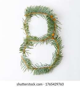 number 8 from green christmas-tree isolated on white. Natural number eight, stylish alphabet. Handmade abc. Text from spruce. Christmas winter Sale. X-mas numbers. Winter font.