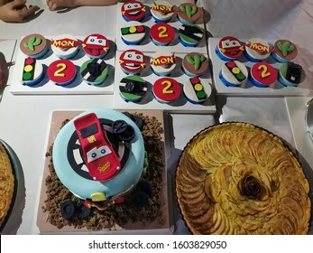 number 95 red Lightning McQueen Cake and Cup Cakes of a little 2 years old boy on New Year Day, Disney Pixar Character, Vientiane, Laos, 1st January 2020. With Apple Pies, Cheese Cake, Oreo Cookies.