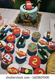 number 95 red Lightning McQueen Cake and Cup Cakes of a little 2 years old boy on the New Year Day, Disney Pixar Car Character, Vientiane, Laos, 1st January 2020. Close up and Background Image.