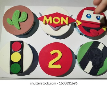 number 95 red Lightning McQueen Cup Cakes of a little 2 years old boy on the New Year Day with baby's fingers, Disney Pixar Car Character, Vientiane, Laos, 1st January 2020. Close up.