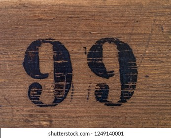 Number 99 on wooden surface