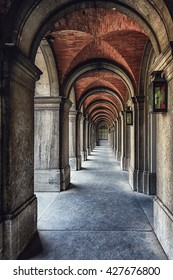 A number of arches with lanterns in one of the Binnenhof, The Hague, Netherlands.