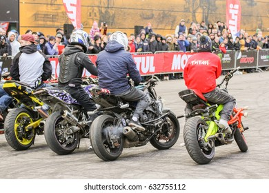 A number of athletes before the start. St. Petersburg Russia - 15 April, 2017. International Motor Show IMIS-2017 in Expoforurum. Sports motorcycle show of bikers on the open area.