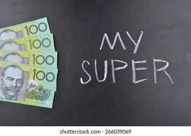 A number of Australian one hundred dollar notes stuck on a blackboard where My Super is handwritten in white chalk.