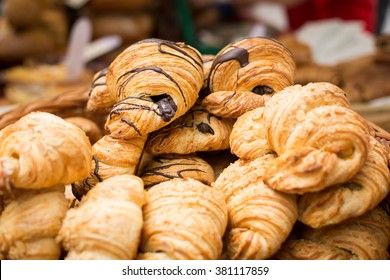 A number of butter croissants and croissants with chocolate