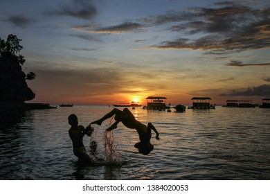 A number of children playing at the seaside oleleresiding in Gorontalo,9 November 2018. Olele beach is one of the famous tourist destination with its bottom in Gorontalo, Indonesia