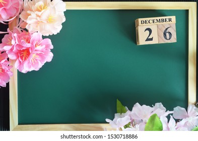 Number cube of Date, Background design with sakura flower on the green board, December 26.