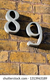 Number eighty nine on exterior wall in strong sunshine