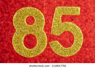 Number eighty-five golden color over a red background. Anniversary. Horizontal