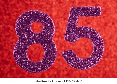 Number eighty-five purple color over a red background. Anniversary. Horizontal