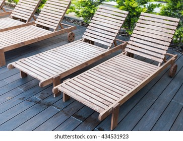 number of empty sunbeds at the pool early in the morning