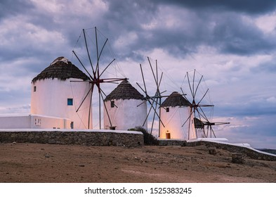 A number of famous windmills on the island of Mykonos at night...