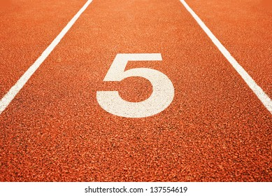 Number five on athletics all weather running track