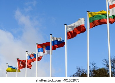 a number of flags of states against the blue sky