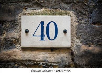 Number forty door number on brick wall