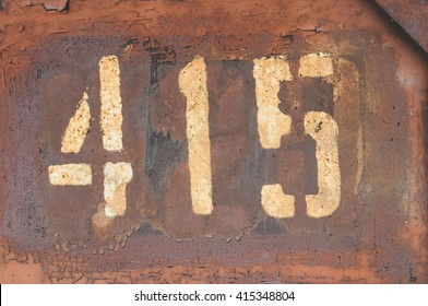 number four hundred and fifteen on old door (4 1 5)