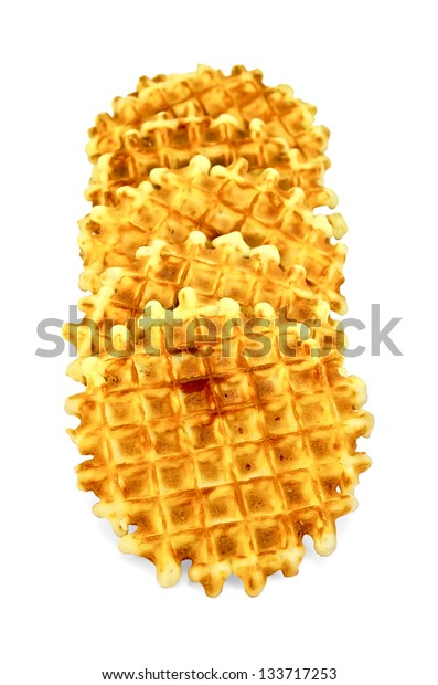 A number of golden round waffles isolated on white background