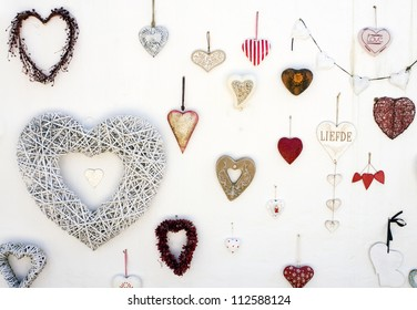 A number of hearts against a white wall