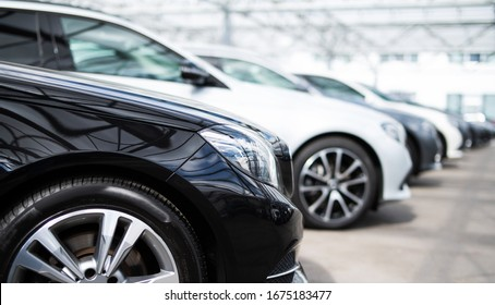 A number of new and used vehicles at a car dealership