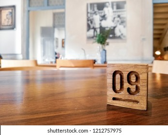 Number Nine (9) wooden sign on dinning table