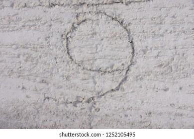 Number nine scratched  on precast concrete