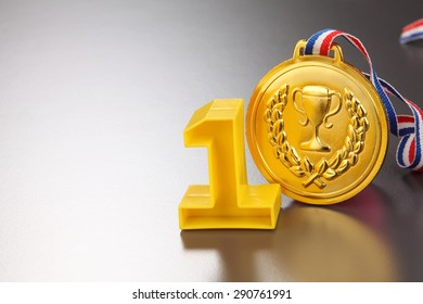 number one and golden medal