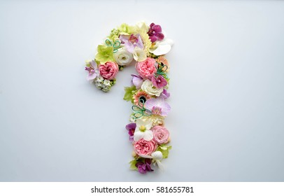 Number one made with flowers in beautiful pastel colors on a white and clean background