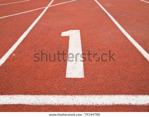 Number one on the start of a running track