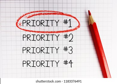 Number one priority marked with red circle on math notebook