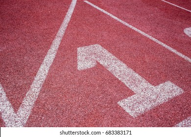 number one start position concept - running track closeup at first place 1 lane.