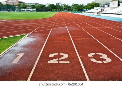 Number one  two and three on the start of a running track