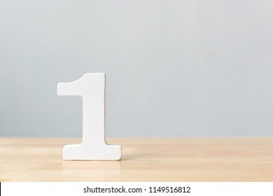 Number one wooden material on table. Concept top winner success with copy space