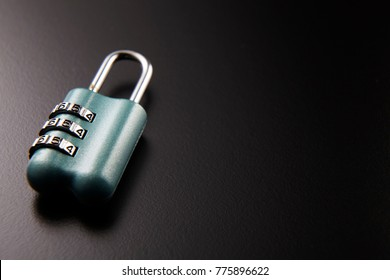 number pad lock on the black background