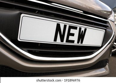 Number plate of a new car for retail sale on a motor dealers forecourt all logos removed